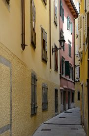 View of old narrow street with colored houses in Trieste Italy.
