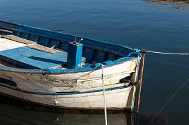 Detail of a small fishing boat in the river