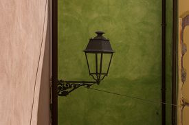 old street lamp on a green background
