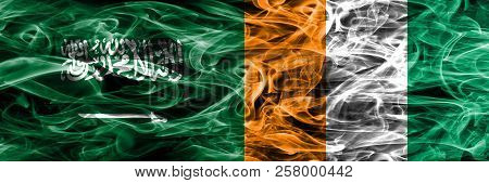Saudi Arabia Vs Ivory Coast Smoke Flags Placed Side By Side. Thick Colored Silky Smoke Flags Of Saud