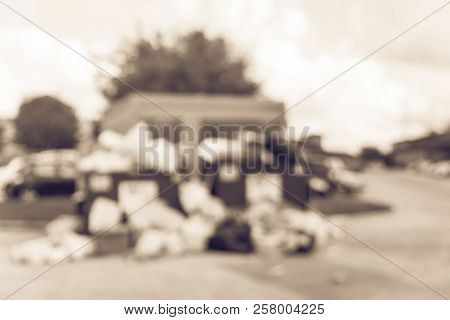 Filtered Tone Blurry Background Overflowing Dumpster At Apartment Complex In Usa