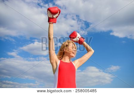 Fight For Female Rights. Girl Leader Promoting Feminism. Woman Boxing Gloves Raise Hands Blue Sky Ba