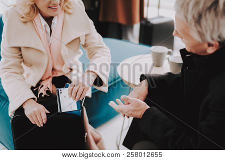 Couples With Tickets In Airport In Waiting Room. Senior Person In Airport. Tourism Concept. Old Coup