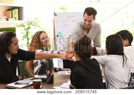 Group Of Businesspersons Stacking Hands Together In Agreement In A Meeting At Office