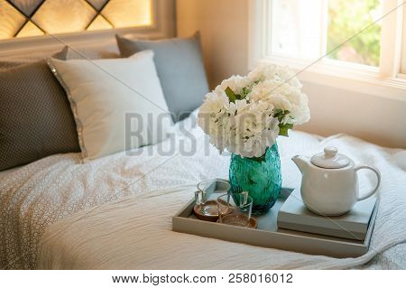 Bedroom Decorative Objects On The Bed In Cozy Vintage Bedroom. Flower Vase, Ceramic Tea Pot, Glass C