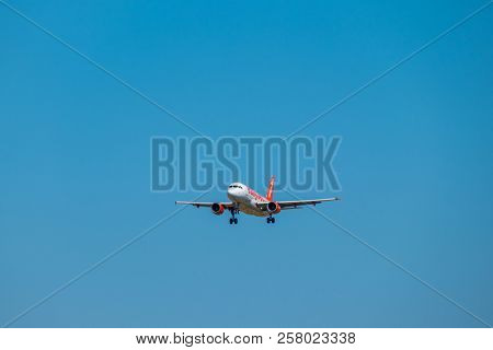 Zurich, Switzerland - July 19, 2018: Easyjet lowcost airlines airplane preparing for landing at day time in international airport