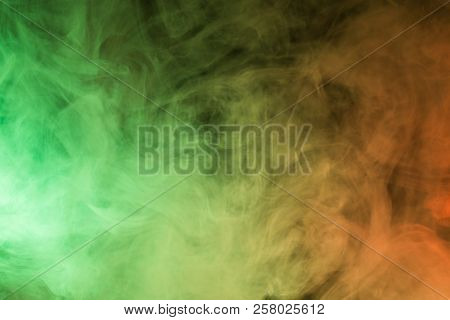 Colorful smoke close-up on a black background poster