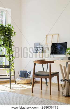 Wooden Chair At Desk With Desktop Computer In White Home Office Interior With Plant On Ladder. Real