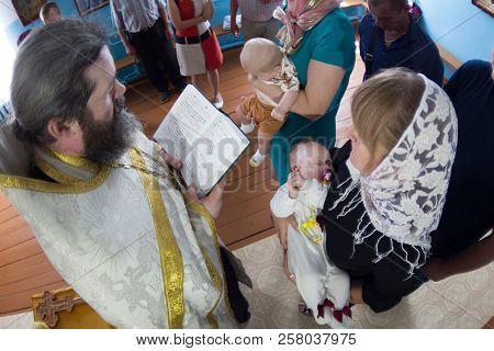 Belarus, Gomel, July 14, 2018. Zyabrovskaya Church. Orthodox Christening Of Children. The Godmothers