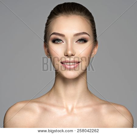 Closeup face of  beautiful young woman with a smile. Beauty treatment concept. Portrait of a pretty  caucasian girl with healthy skin.