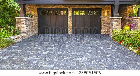 Brick Stone Driveway Double Garage Doors Pano