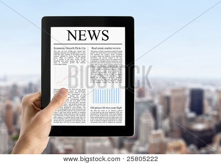Hand Holds Tablet PC With News