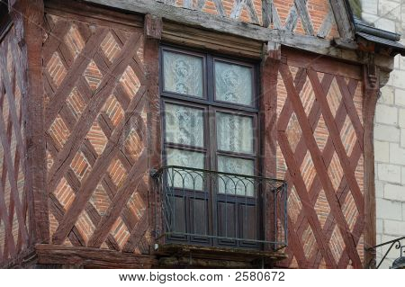 a window of an old-fashioned hurdle