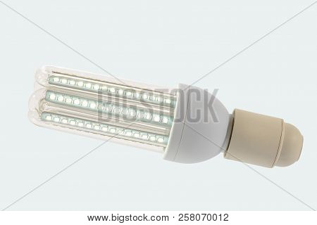 Led Lamp In On Position With  Glass Bulb And E27 Socket. White Background.