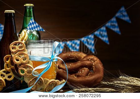 October Fest Concept. Wooden Table In Pub Mug Pint Glass Cup Of Beer With Blue Tape, Snacks, Chips,