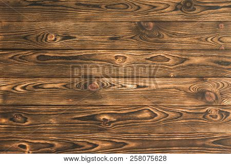 Background Texture Of Rustic Brown Natural Wood With A Distinctive Woodgrain Pattern For Use As A De