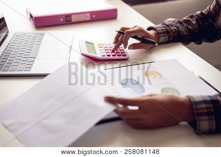 Business And Finance Investment Concept : Businessman Check About Cost And Doing Finance Graph Repor