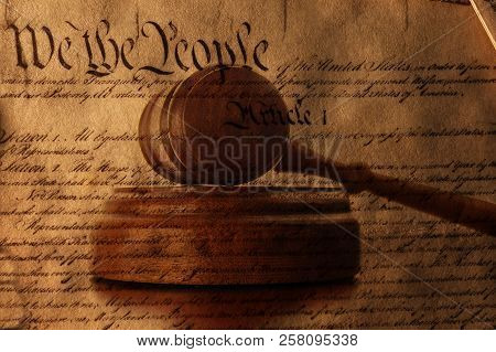 United States Constitution Text Superimposed Over A Legal Gavel