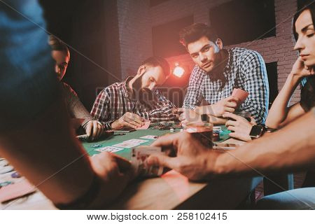Young Friends Playing Poker On Party At Home. Playing Games. Indoor Fun. Young Girl. Young Guy. Sitt