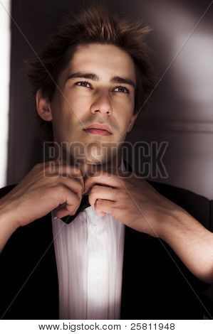 Man Getting Ready For Black Tie Formal Event