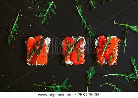 Sandwiches With Cream Cheese, Salmon And Arugula.