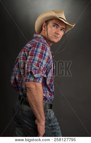 The Sexy Cowboy Poses For The Camera.