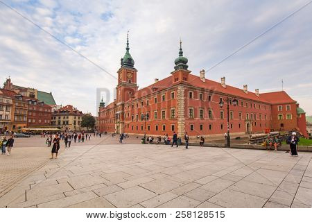 Warsaw, Poland - September 5, 2018: People on the Royal Castle square in Warsaw city at sunset, Poland. Warsaw is the capital and largest city of Poland.