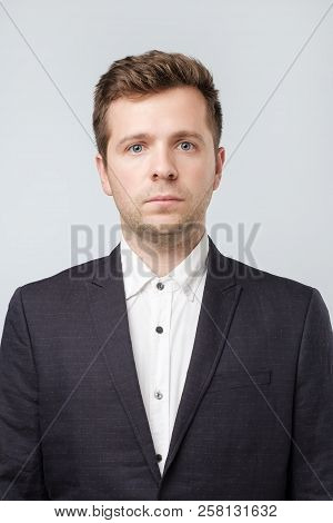Photo For Document Or Passport Id. Mature Caucasian Man In Suit