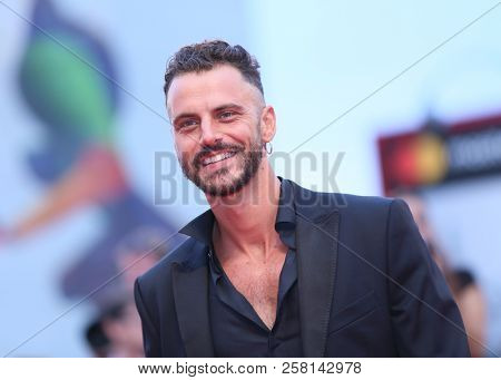 Andrea Montovoli walks the red carpet ahead of the 'One Nation One King (Un Peuple Et Son Roi)' screening during the 75th Venice Film Festival at Sala Grande on September 7, 2018 in Venice, Italy.