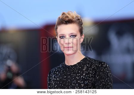 Celine Sallette walks the red carpet ahead of the 'One Nation One King (Un Peuple Et Son Roi)' screening during the 75th Venice Film Festival at Sala Grande on September 7, 2018 in Venice, Italy.