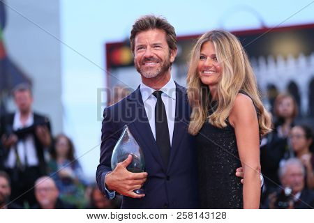 Paolo Conticini and Giada Parra walk the red carpet ahead of the 'One Nation One King (Un Peuple Et Son Roi)' screening during the Venice Festival at Sala Grande on September 7, 2018 in Venice, Italy.