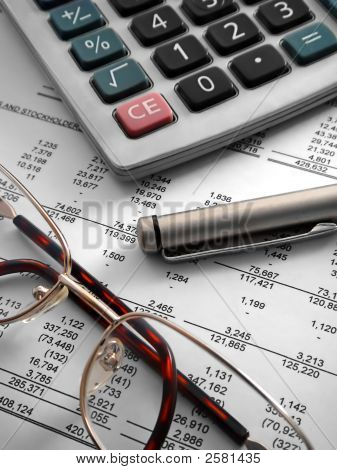 Calculator, Pen And Glasses On Financial Statement