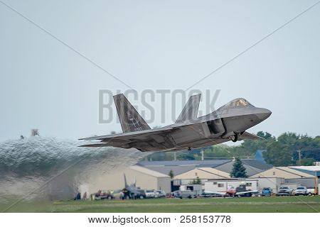 Oshkosh, Wi - 28 July 2018:  A F-22 Taking Off With Full Afterburner At An Airshow