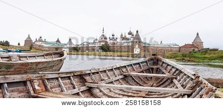 Panorama Of The Solovetsky Monastery With Old Broken Boats On The Foreground In Inclement Weather, B