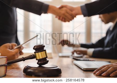 Teamwork Of Business Lawyer Shaking Hands Meeting After Great Meeting About Legal Legislation In Cou