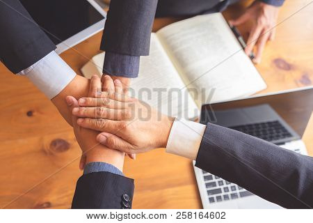 Business People Joining Hands After Successful Meeting. Business Teamwork Concept.