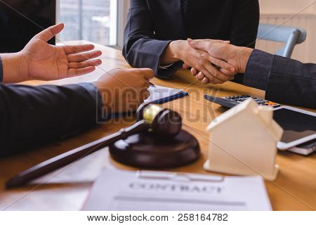 Teamwork Of Business Legal Shaking Hands Meeting After Great Meeting About Property Law In Courtroom