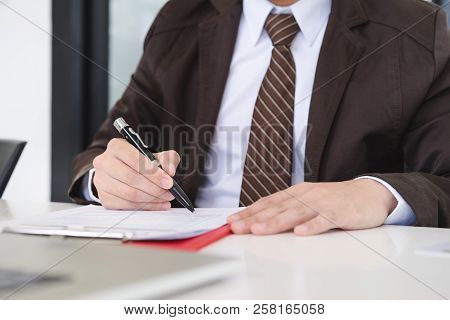 Hands Of Businessman Brown Suit Are Signing Contract Agreement. Contract Agreement Policy Concept.