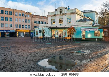 Uzhgorod, Ukraine - Nov 10, 2012: Puppet Theater On Theatral Square Atfer The Autumn Rain At Sunrise