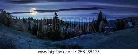 Panorama Of Village In Apuseni Mountains. Beautiful Autumn Landscape At Night In Full Moon Light. Mi