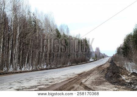 Dull, Dirty Road In Early Spring, Late Autumn Or Winter In Russia