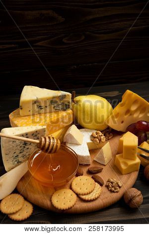 Different Types Of Cheeses On A Blackboard