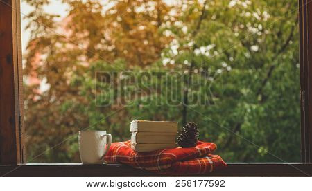 Cozy Autumn Still Life: Cup Of Hot Coffee And Opened Book On Vintage Windowsill With Red Blanket, Pu