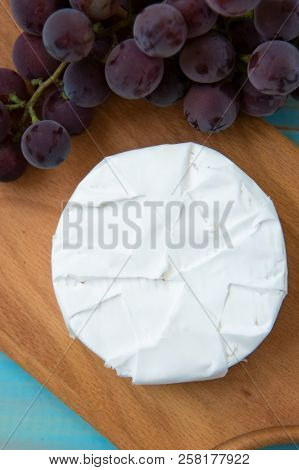 Camembert, With A Fork For Cheese And Grape