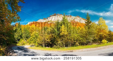 Panorama Of Gorgeous Serpentine In Autumn Forest. Huge Rocky Formation On The Hill Above The Path. B