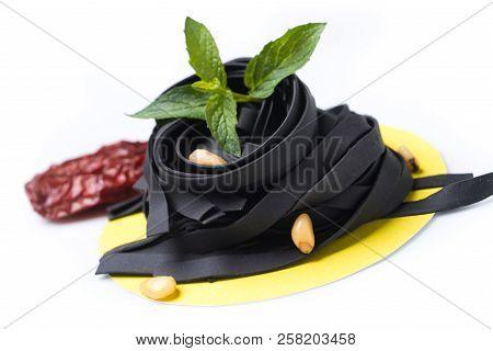 Uncoocked Black Tagliatelle On Gastronomic Plate Composition