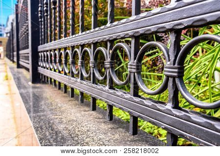 Wrought Iron Fence Close Up. Black Metal Fence