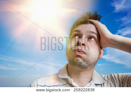 Young Man Is Sweating. Hot Weather Concept. Sun In Background.