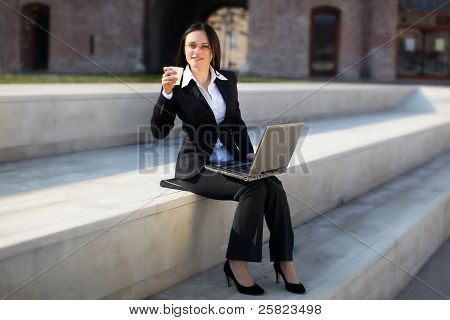 A Businesswoman Is Drinking Coffee