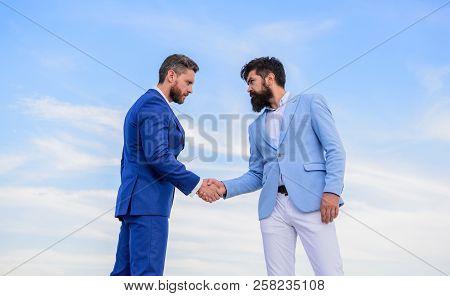 Sure Sign You Should Trust Business Partner. Men Formal Suits Shaking Hands Blue Sky Background. Ent